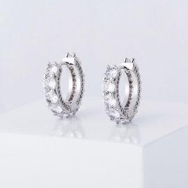 Iced Huggie Earrings in White Gold